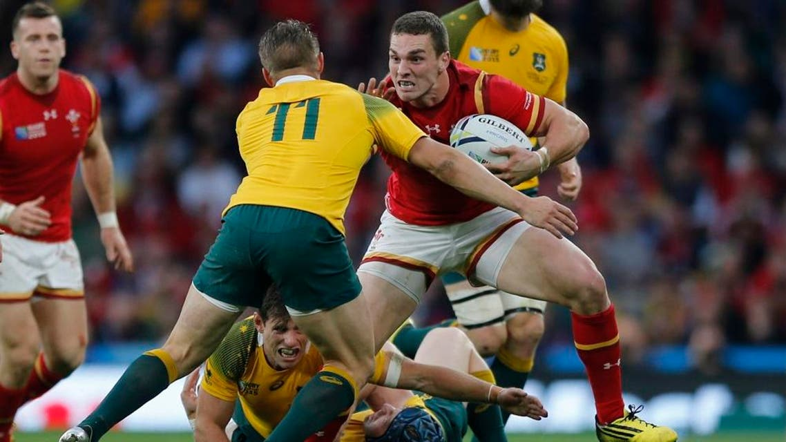 Wales' George North is tackled by Australia's Drew Mitchell during the Rugby World Cup Pool A match between Australia and Wales at Twickenham Stadium, London, Saturday, Oct. 10, 2015. (AP Photo/Frank Augstein)