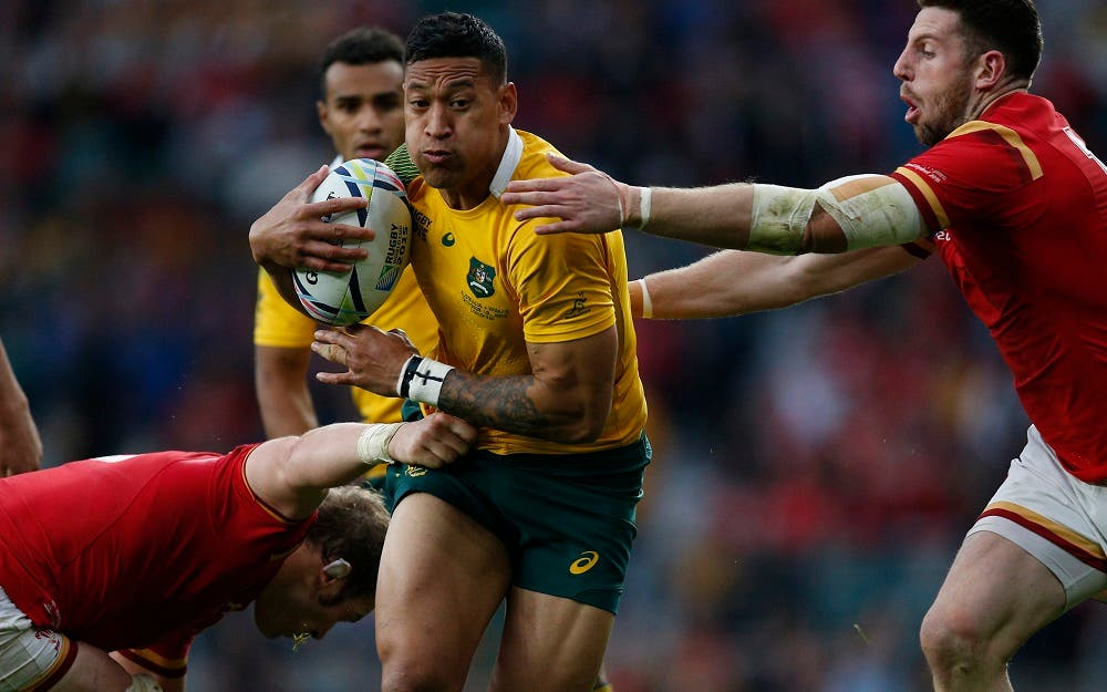 Australia's Israel Folau is tackled by the Wales defence during the Rugby World Cup Pool A match between Australia and Wales at Twickenham Stadium, London, Saturday, Oct. 10, 2015. (AP Photo/Christophe Ena)