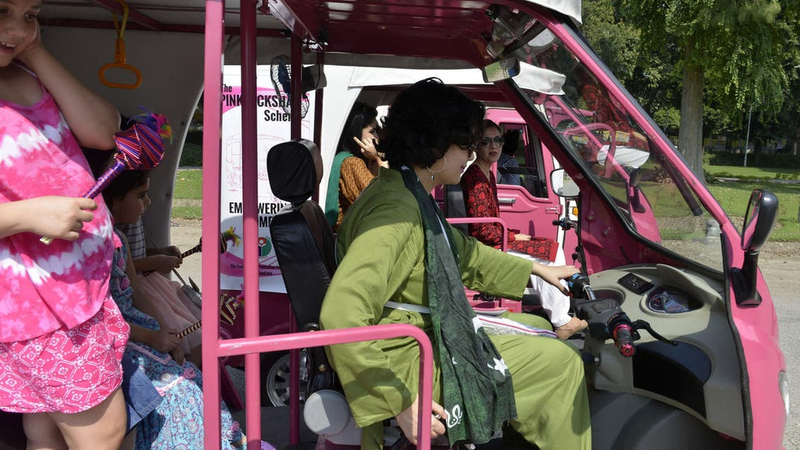 Pakistani women prepare to drive pink auto-rickshaws during a rally in Lahore on October 10, 2015. AFP
