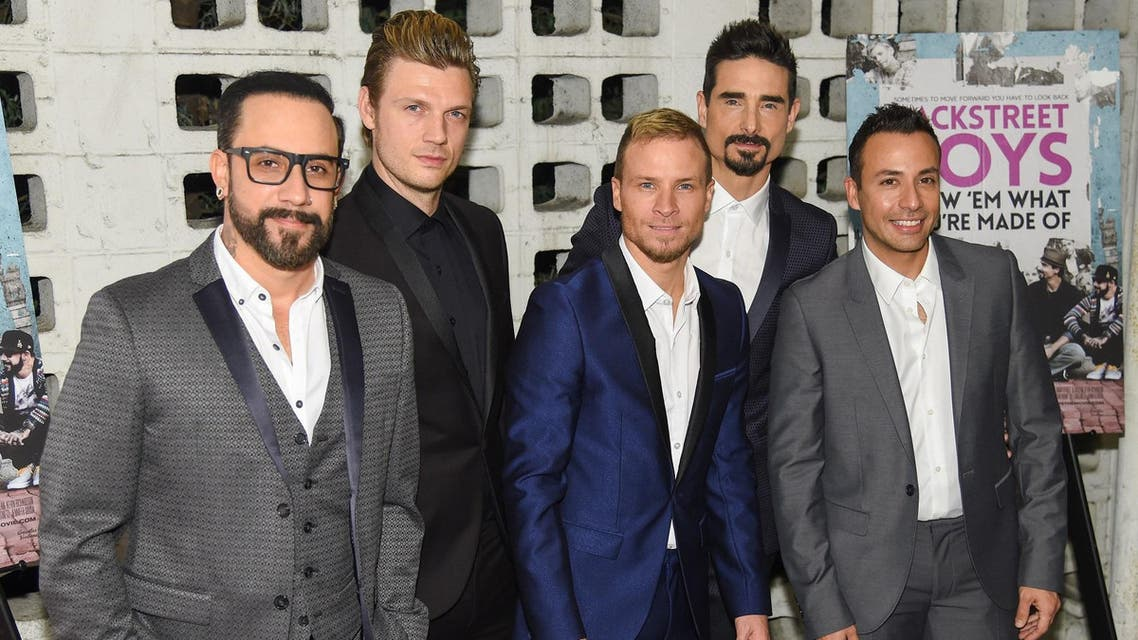 """A.J. McLean, from left, Nick Carter, Brian Littrell, Kevin Richardson and Howie Dorough arrive at the """"Backstreet Boys: Show 'Em What You're Made Of"""" premiere at the Arclight Cinemas. (AP)"""