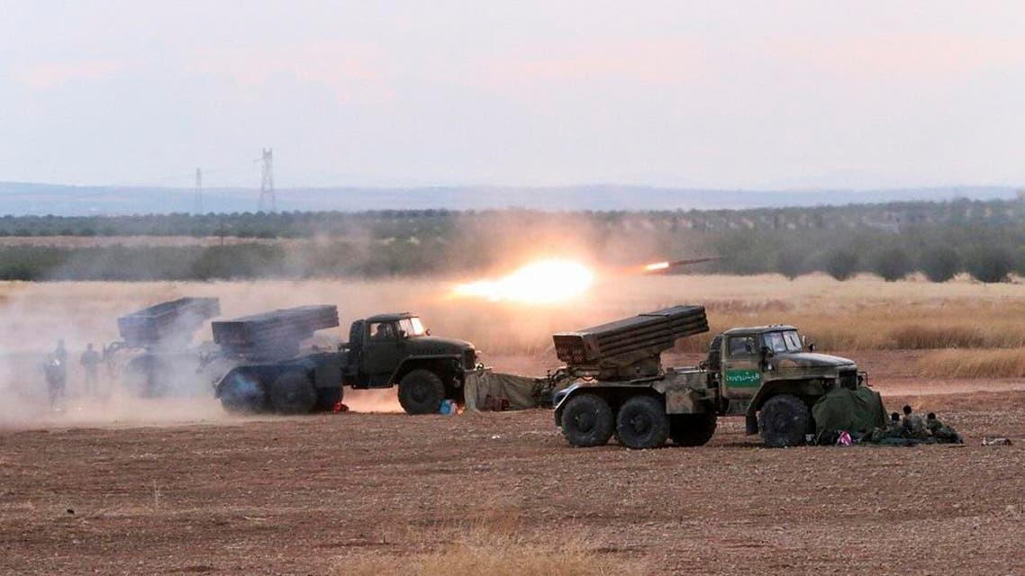 In this photo taken on Wednesday, Oct. 7, 2015, Syrian army rocket launchers fire near the village of Morek in Syria. The Syrian army has launched an offensive this week in central and northwestern Syria aided by Russian airstrikes. (AP Photo/Alexander Kots, Komsomolskaya Pravda, Photo via AP)