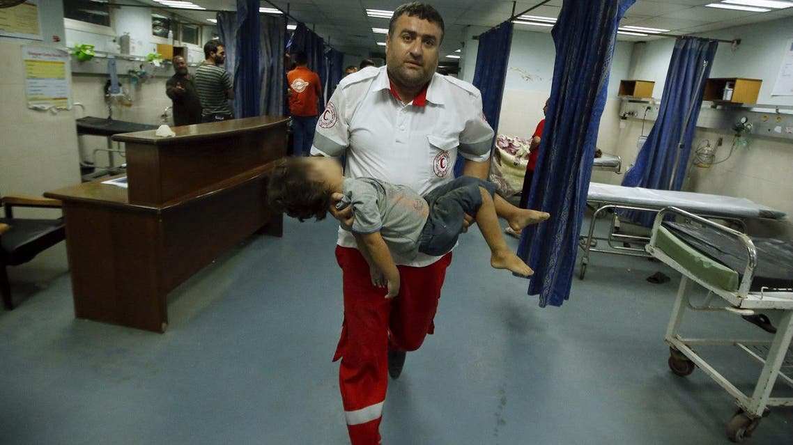 A medic carries the body of a three-year-old Palestinian girl who was killed after her house was brought down by an Israeli air strike in Gaza early on October 11, 2015. An Israeli air strike on a Hamas target in the Gaza Strip on Sunday brought down a nearby house killing a Palestinian woman and her daughter, hospital officials said, as a wave of violence in the region triggered fears of wider escalation. REUTERS