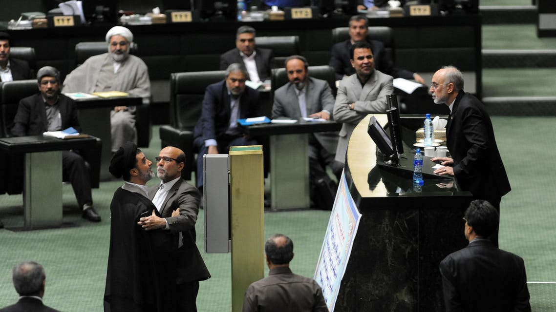 TEH001 - Tehran, -, IRAN : Iran's head of Atomic Energy Organisation (IAEO) Ali Akbar Salehi (R) argues with a member of parliament during a session in Tehran on October 11, 2015. Iran's parliament gave a partial nod to a nuclear deal with world powers Sunday but only after fiery clashes and allegations from a top negotiator that a lawmaker had threatened to kill him. AFP PHOTO / ISNA / AMIN KHOROSHAHI