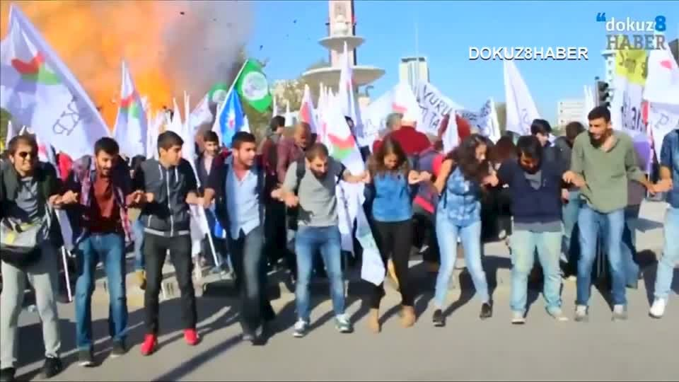 Still image taken from video shows protesters dancing during a peace rally as a blast goes off in Ankara. (Reuters)