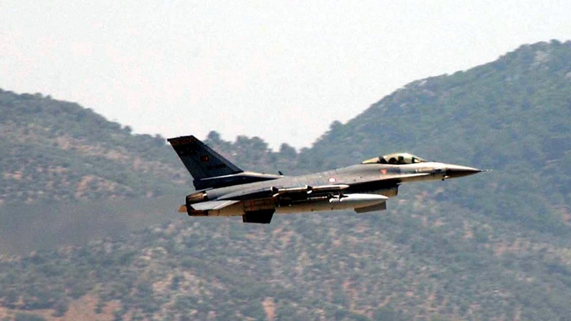 A Turkish Air Force F-16 fighter jet flies over a military airbase in Dalaman near the southwestern Turkish city of Mugla, Tuesday, May 23, 2006. A Greek and a Turkish warplane collided Tuesday over the Aegean Sea island of Karpathos as they shadowed each other. The Turkish pilot was rescued by a merchant ship, while a Greek helicopter and navy vessels searched for the Greek pilot after the two F-16 jets crashed into the sea 20 kilometers, 12.5 miles, south of Karpathos. (AP Photo/Anatolia, Kenan Gurbuz) ** TURKEY OUT **