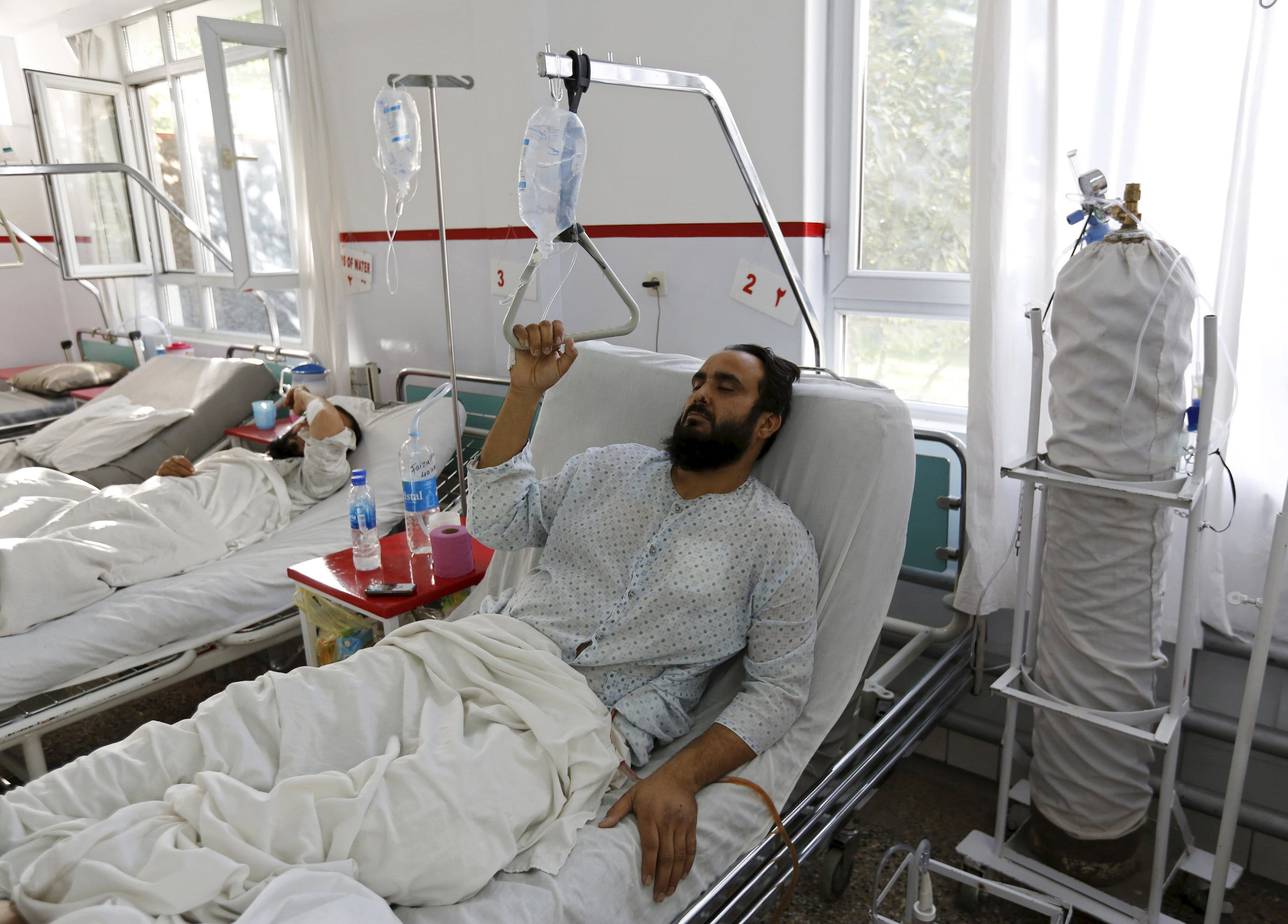 A wounded Afghan man, who survived a U.S. air strike on a Medecins Sans Frontieres (MSF) hospital in Kunduz, receives treatment at the Emergency Hospital in Kabul October 8, 2015. The U.S. air strike in Afghanistan that killed at least 22 patients and staff at the Medecins Sans Frontieres hospital wasn't the first time the escalating war has affected an aid-run medical facility. There have even been instances since. Foreign aid workers and Afghan colleagues shaken by the weekend tragedy in Kunduz, one of the worst incidents of its kind in the 14-year war, say increased violence around the country makes it harder to provide basic services in a country where NGOs help provide the vast majority of healthcare. To match Insight AFGHANISTAN-HEALTH/VIOLENCE REUTERS/Mohammad Ismail