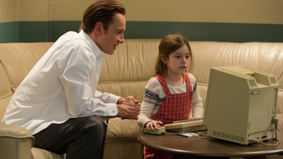 In this image released by Universal Pictures, Michael Fassbender, left, as Steve Jobs and Makenzie Moss as a young Lisa Jobs, appear in a scene from the film, Steve Jobs. (AP)