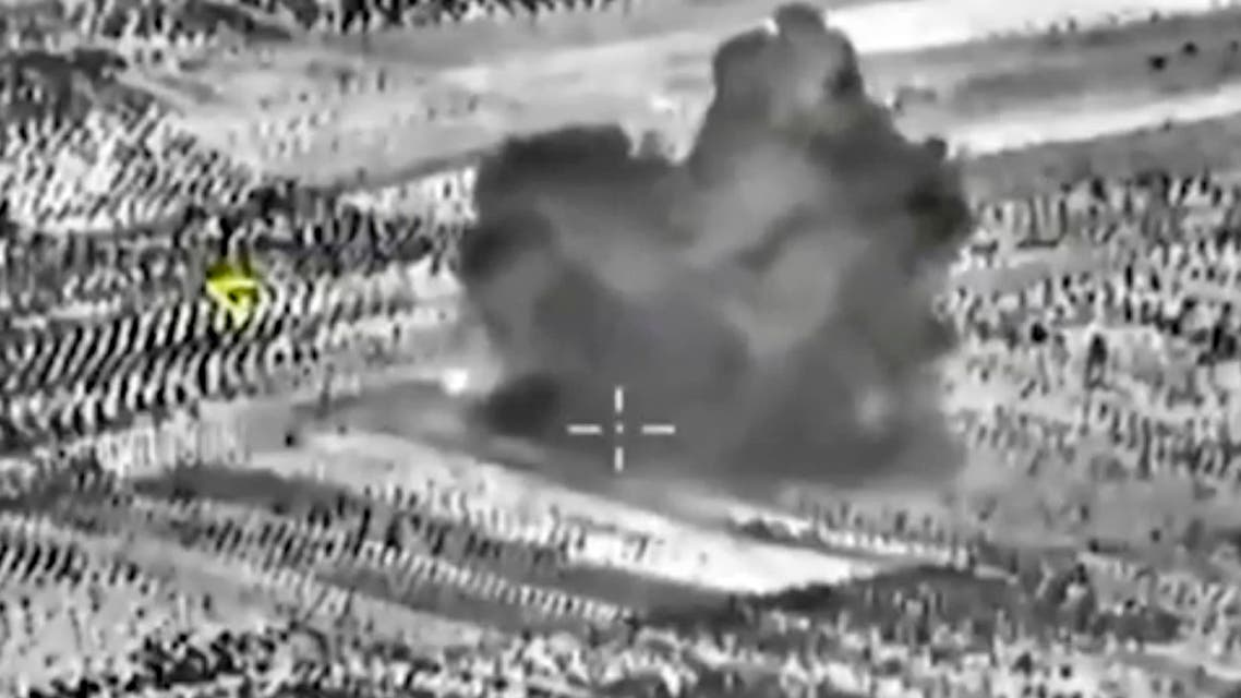 This image made from footage taken from Russian Defense Ministry official website on Friday, Oct. 2, 2015, shows another attack made from a fighter jet in Syria.  AP