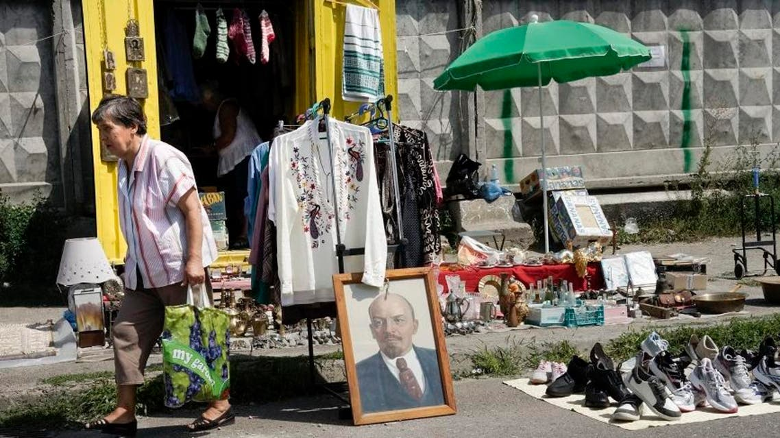 Lenin's portrait is for sale at a market in Ukraine's capital Kiev, where people were in August selling their belongings in an attempt to survive in a financial crisis. (AP Photo)