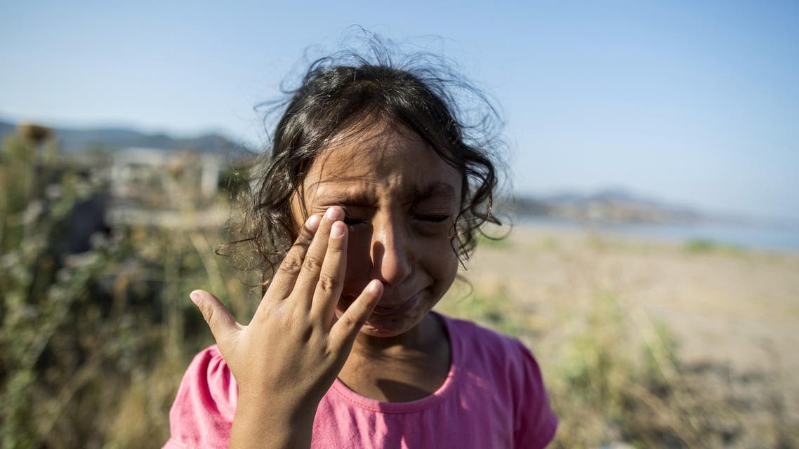Yasmine, a 6-year-old migrant from Deir Al Zour in war-torn Syria, cries at the beach after arriving on the Greek island of Lesbos September 11, 2015. (Reuters)