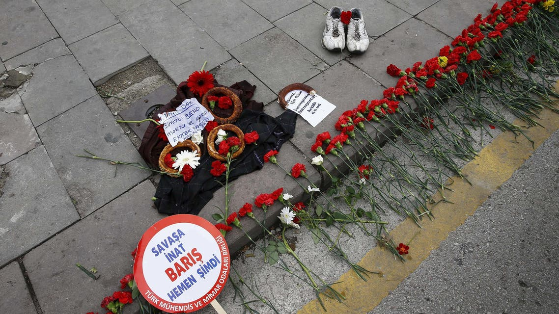 A pair of shoes, belonging to a street vendor who was selling Turkish traditional bagel or simit, is placed at the bombing scene during a commemoration for the victims of Saturday's bomb blasts, in Ankara, Turkey, October 12, 2015.