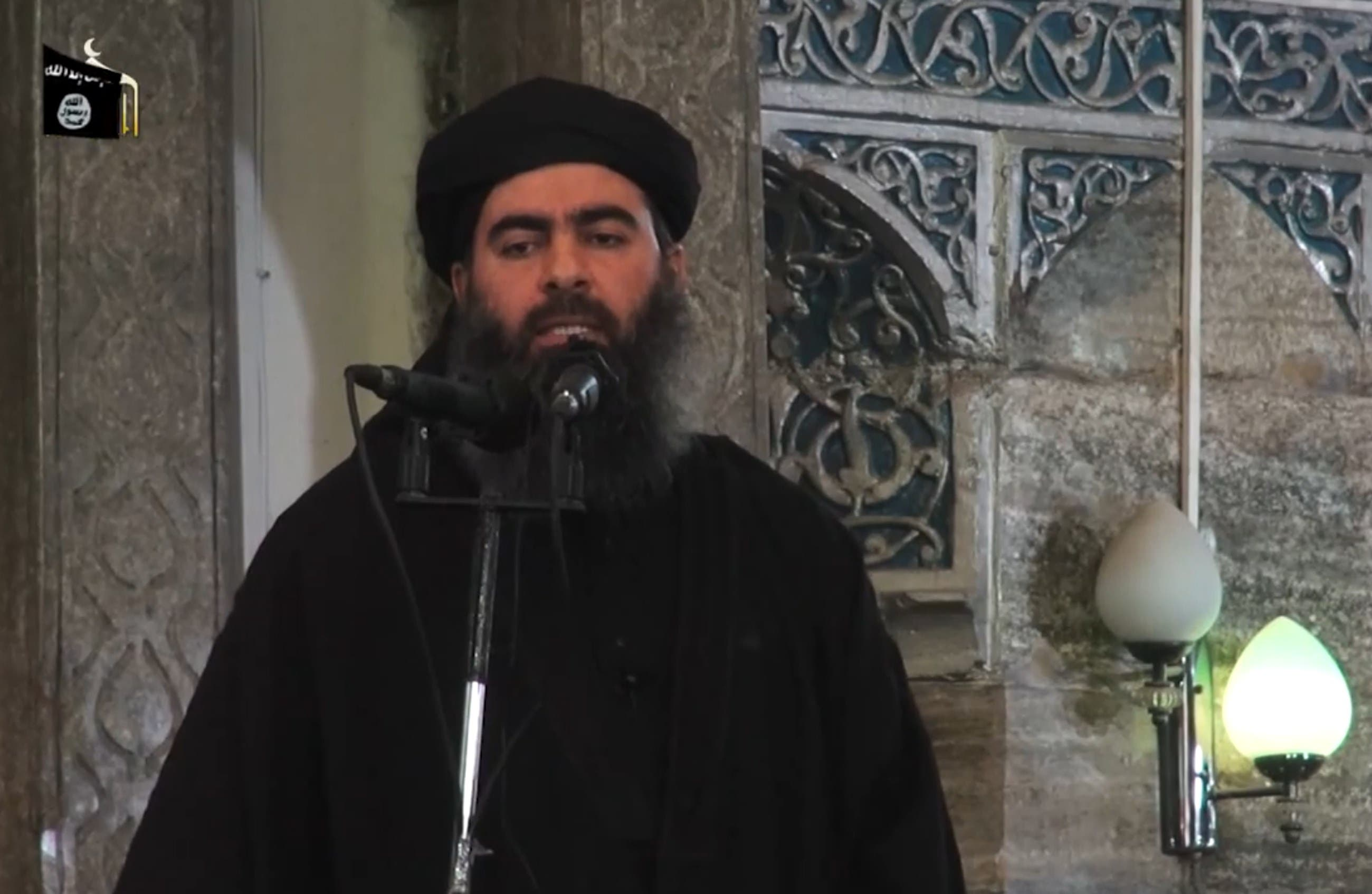 An image grab taken from a propaganda video released on July 5, 2014 by al-Furqan Media allegedly shows the leader of the Islamic State (IS) jihadist group, Abu Bakr al-Baghdadi afp