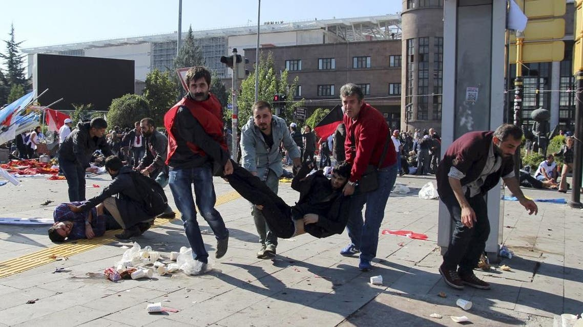 """People carry an injured man after an explosion during a peace march in Ankara, Turkey, October 10, 2015. At least one explosion shook a road junction in the centre of the Turkish capital Ankara on Saturday, causing many casualties including fatalities, local media said. The state-run Anadolu Agency said there were reports that the blast was caused by a suicide bomber, but the source of those reports was unclear. The blast occurred ahead of a planned """"peace"""" march to protest against the conflict between the state and Kurdish militants in southeast Turkey. Earlier media reports had said there were two explosions. REUTERS/Tumay Berkin"""