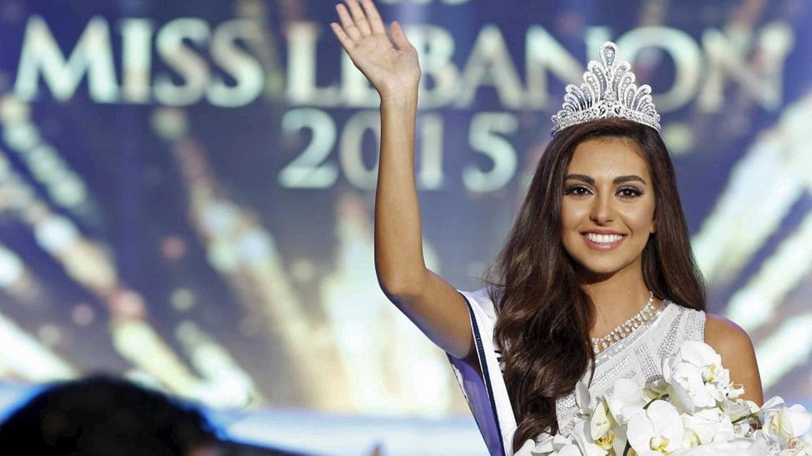 Valerie Abou Chacra waves after being crowned Miss Lebanon 2015 in Beirut October 12, 2015. REUTERS/Mohamed Azakir