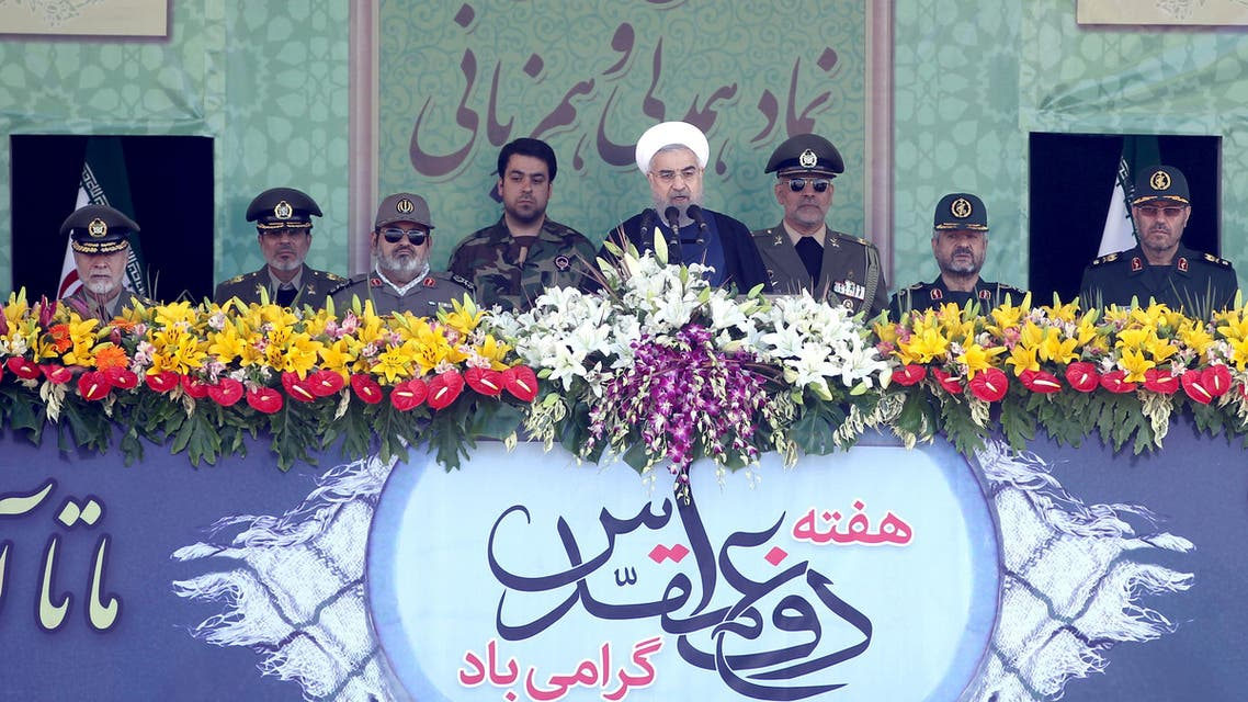 Iranian President Hassan Rouhani (C) delivers a speech as military commanders attend a parade marking the anniversary of the Iran-Iraq war (1980-88), in Tehran September 22, 2015. (Reuters)