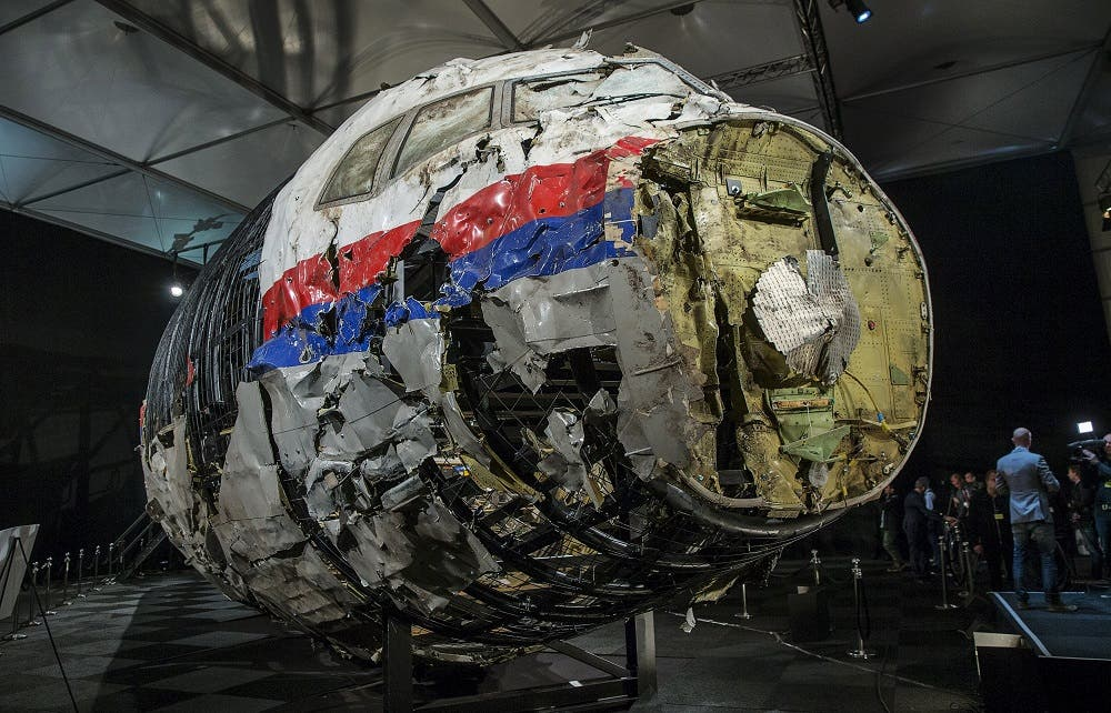 The reconstructed wreckage of the MH17 airplane is seen after the presentation of the final report into the crash of July 2014 of Malaysia Airlines flight MH17 over Ukraine, in Gilze Rijen, the Netherlands, October 13, 2015.