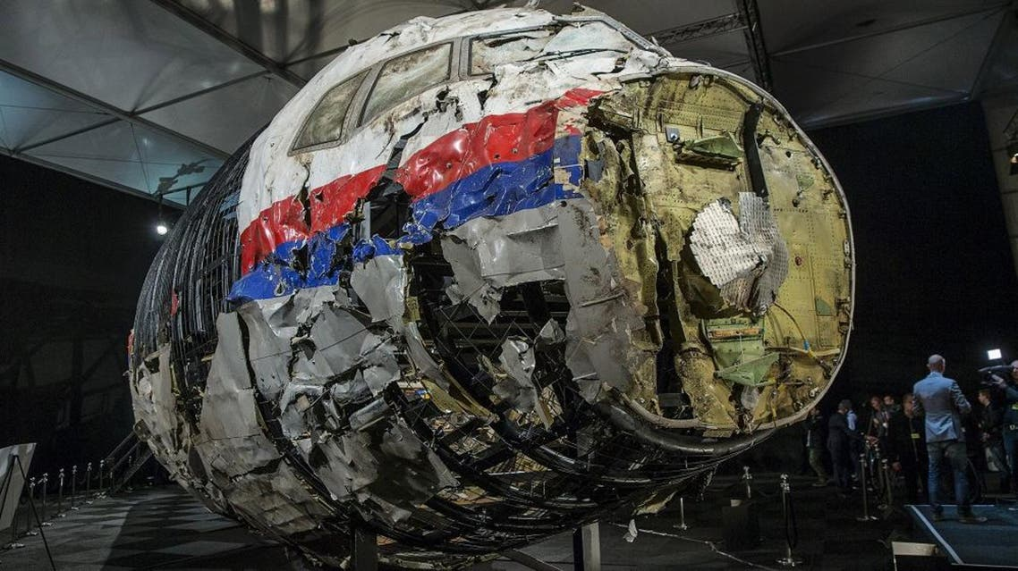 The reconstructed wreckage of the MH17 airplane is seen after the presentation of the final report into the crash of July 2014 of Malaysia Airlines flight MH17 over Ukraine, in Gilze Rijen, the Netherlands, October 13, 2015. Malaysian Airlines Flight 17 was shot down over eastern Ukraine by a Russian-made Buk missile, the Dutch Safety Board said on Tuesday in its final report on the July 2014 crash that killed all 298 aboard. The long-awaited findings of the board, which was not empowered to address questions of responsibility, did not specify who launched the missile. REUTERS/Michael Kooren