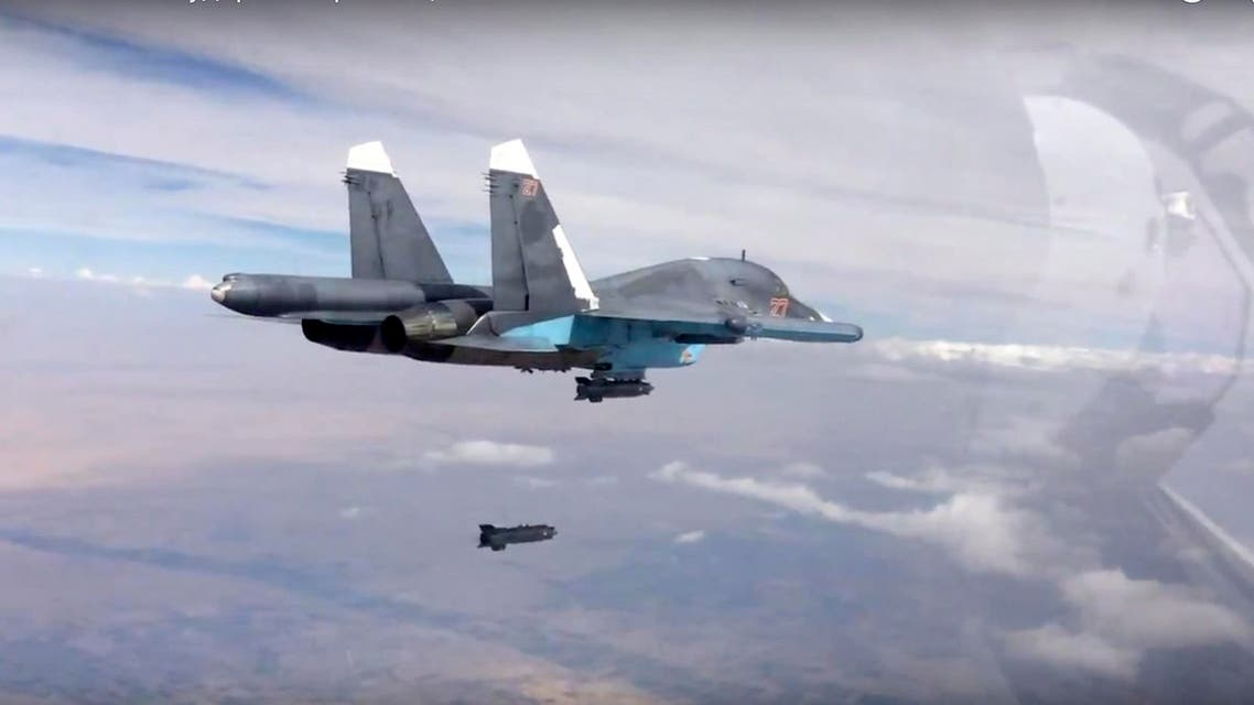 In this photo made from the footage taken from Russian Defense Ministry official web site on Friday, Oct. 9, 2015, a bomb is released from Russian Su-34 strike fighter in Syria. AP