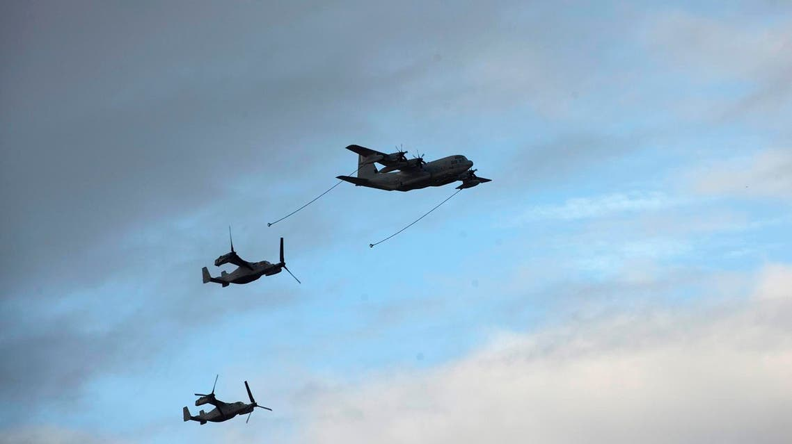 """United States Marine Corps Bell Boeing V-22 Ospreys take positions to be refuelled by a Spain's Lockheed C-130 """"Hercules"""", during a bilateral training exercise. (AP)"""