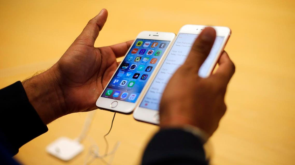 A customer tries out new Apple iPhone 6S at an Apple store on Chicago's Magnificent Mile. (AP)