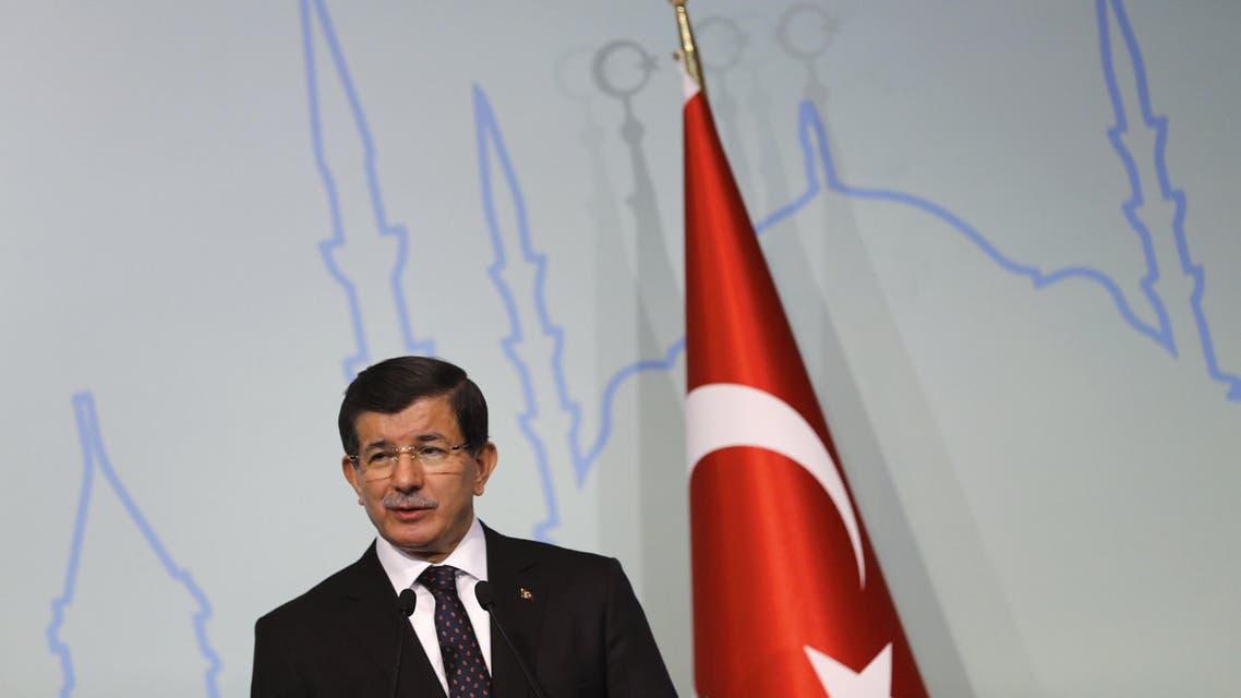 Turkish Prime Minister Ahmet Davutoglu speaks during a news conference in Istanbul, Turkey, October 14, 2015. REU