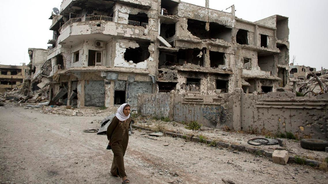 n this June 5, 2014, file photo, a woman walks through a devastated part of Homs, Syria. (AP)