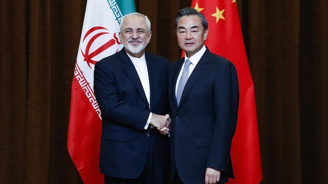 Chinese Foreign Minister Wang Yi, right, and Iranian Foreign Minister Mohammad Javad Zarif pose for photos before a bilateral meeting Tuesday, Sept. 15, 2015 in Beijing, China. ap