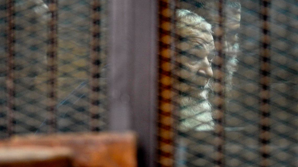 Brother of al-Qaida's deputy leader, Mohammed al-Zawahri stands in a defendants cage in the Police Academy courthouse in Cairo, Egypt, Monday, Aug. 10, 2015. AP