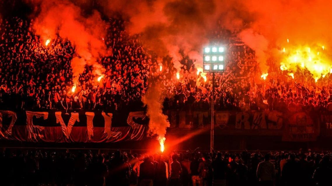 Hardcore soccer fans, pictured on Feb. 1 2015, light flares during the third anniversary of the 2012 Port Said soccer riot, in which more than 70 people were killed. (AP Photo)