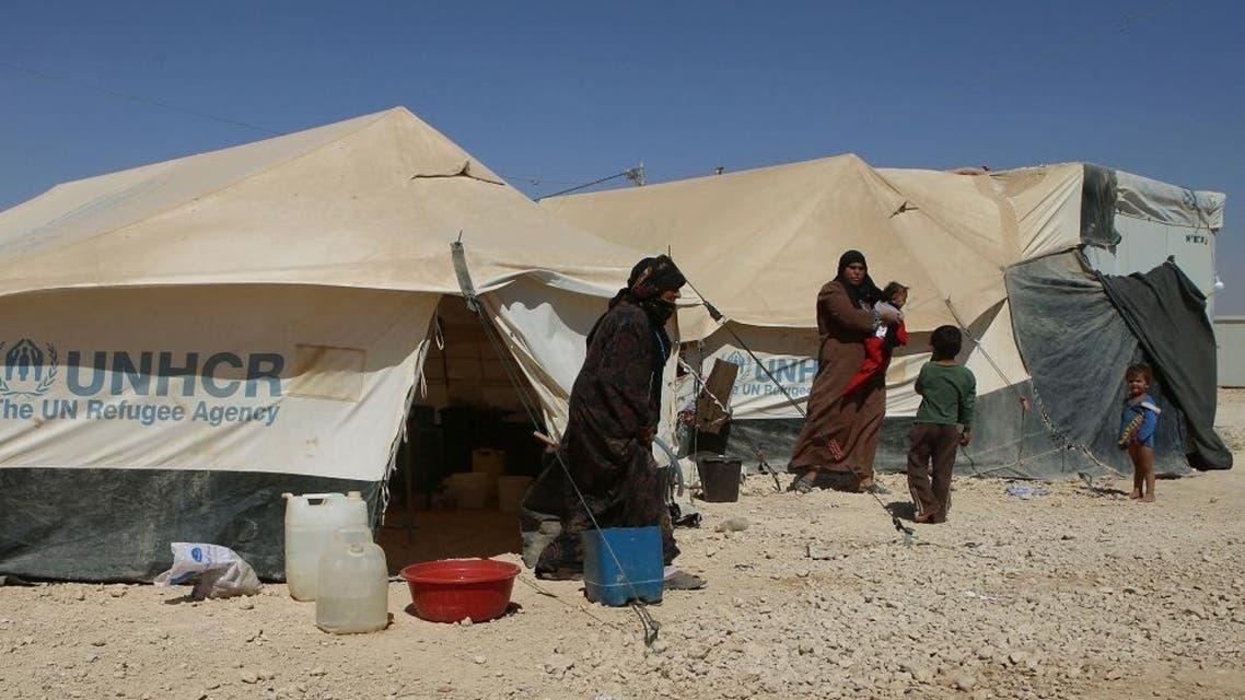 Syrian refugees hang out by their tents at the U.N.-run Zaatari refugee camp near Mafraq, northern Jordan. (AP Photo)