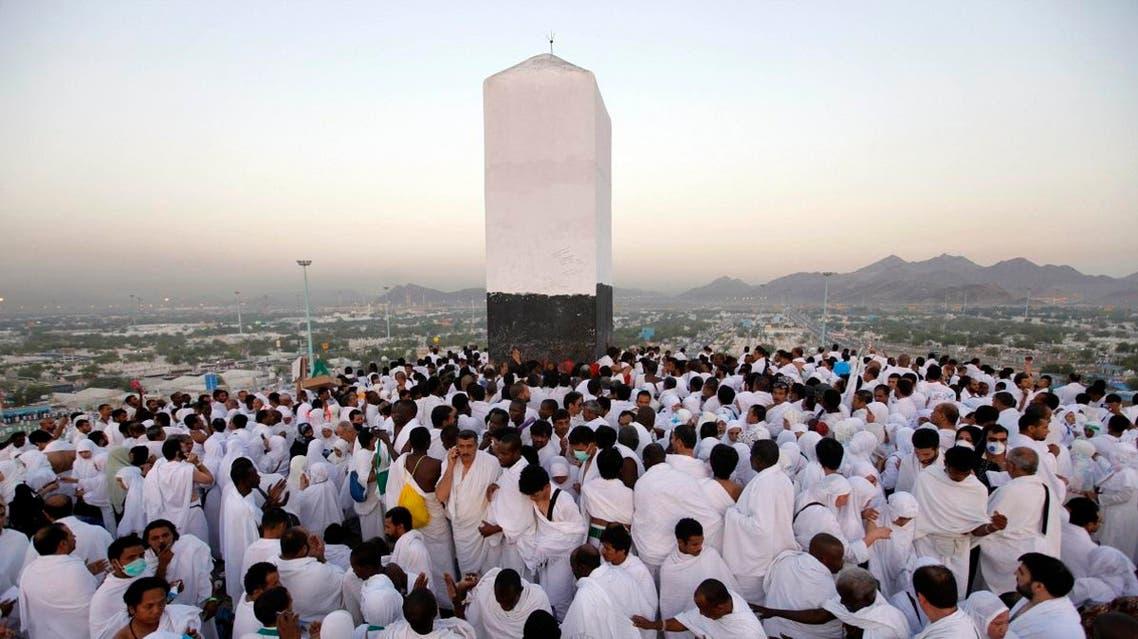 Muslim pilgrims pray on a rocky hill called the Mountain of Mercy, near the holy city of Makkah. (AP)