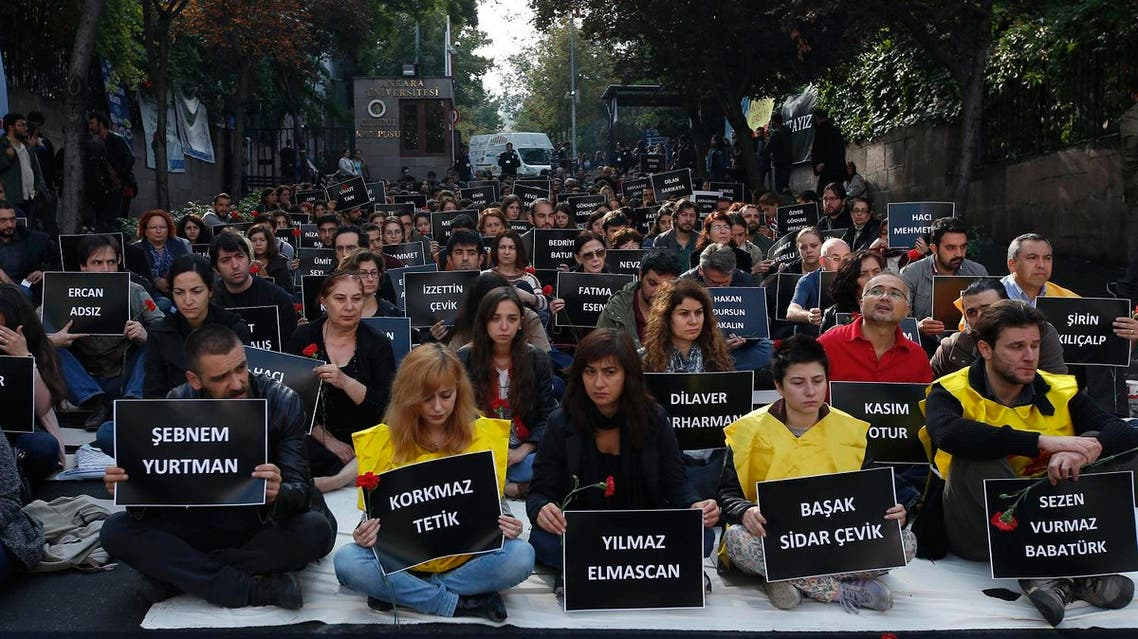 The students of Ankara University hold the placards with the names of those killed in Saturday's deadly explosions during a sit-in protest in Ankara. (AP)