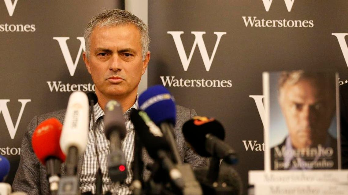 Chelsea football club manager Jose Mourinho speaks during a press conference to promote the book 'Mourinho' after an autograph session at a book store in London, Thursday, Oct. 15, 2015. (AP Photo/Frank Augstein)