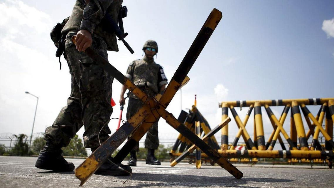 South Korean soldiers set up barricades at a checkpoint on the Grand Unification Bridge which leads to the truce village Panmunjom, just south of the demilitarised zone separating the two Koreas, in Paju, South Korea, August 22, 2015. (Reuters)