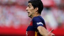 Barca's Suarez foresees competitive title race