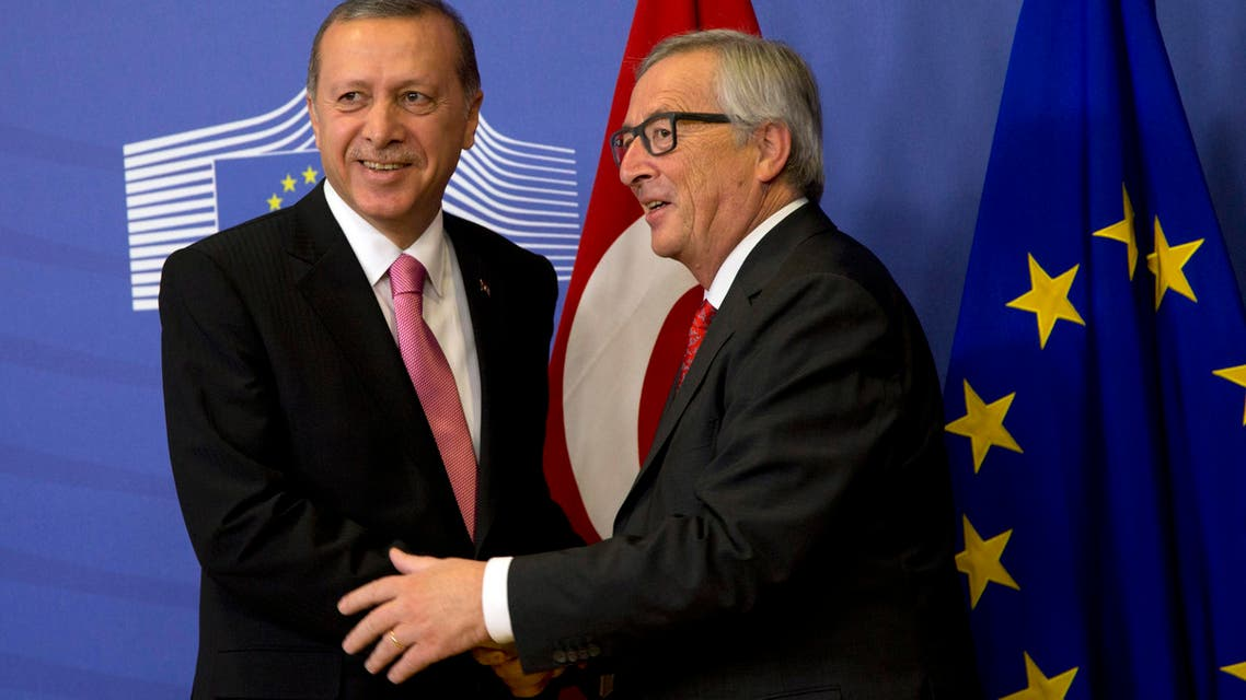 Turkish President Recep Tayyip Erdogan, left, is greeted by European Commission President Jean-Claude Juncker prior to a meeting at EU headquarters in Brussels on Monday, Oct. 5, 2015.