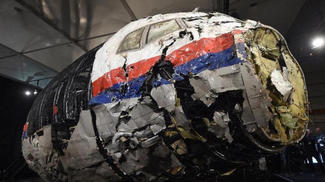 The wrecked cockipt of the Malaysia Airlines MH17 plane that was shot down in Ukraine, killing 298 people, is shown to reporters on October 13, 2015 (AFP)