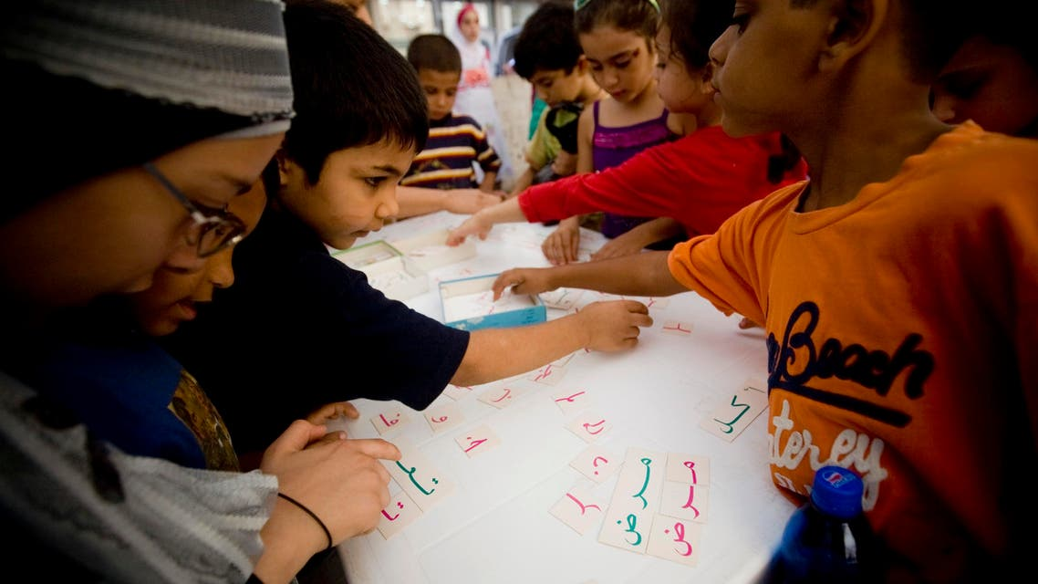 Lebanese school children arrange Arabic alphabets during an all-day Arabic language festival entitled 'We Are Our Language' in Beirut, Lebanon.