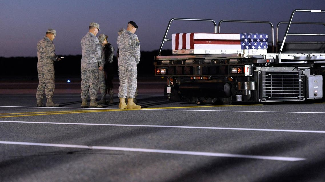 A transfer case containing the remains of Army Spc. Kyle E. Gilbert sits on a loader during a prayer at Dover Air Force Base, Del., Wednesday, Sept. 23, 2015. (AP)