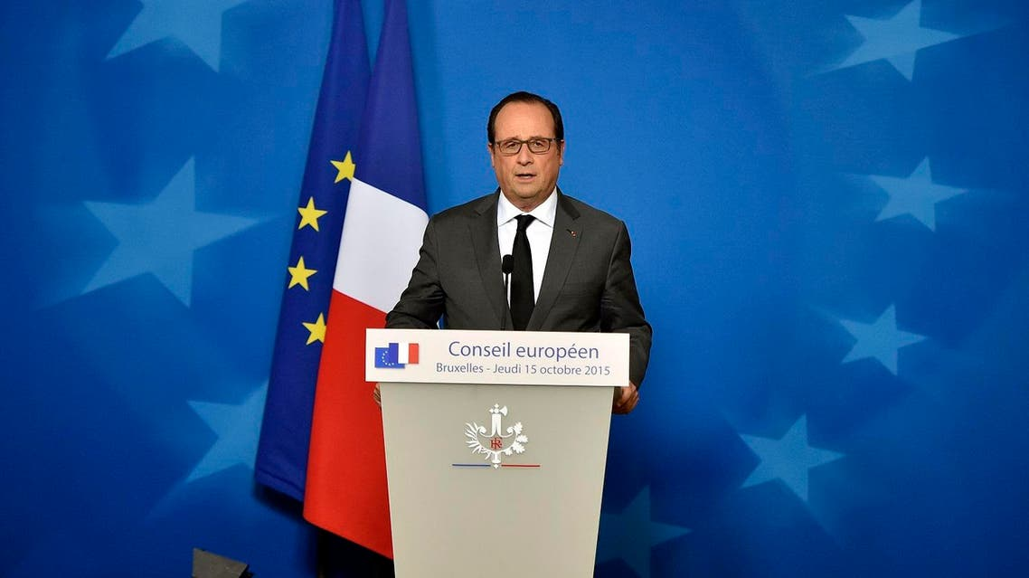 French President Francois Hollande talks to the media at a press conference after the EU summit in Brussels, Belgium on early Friday, Oct. 16, 2015. (AP)