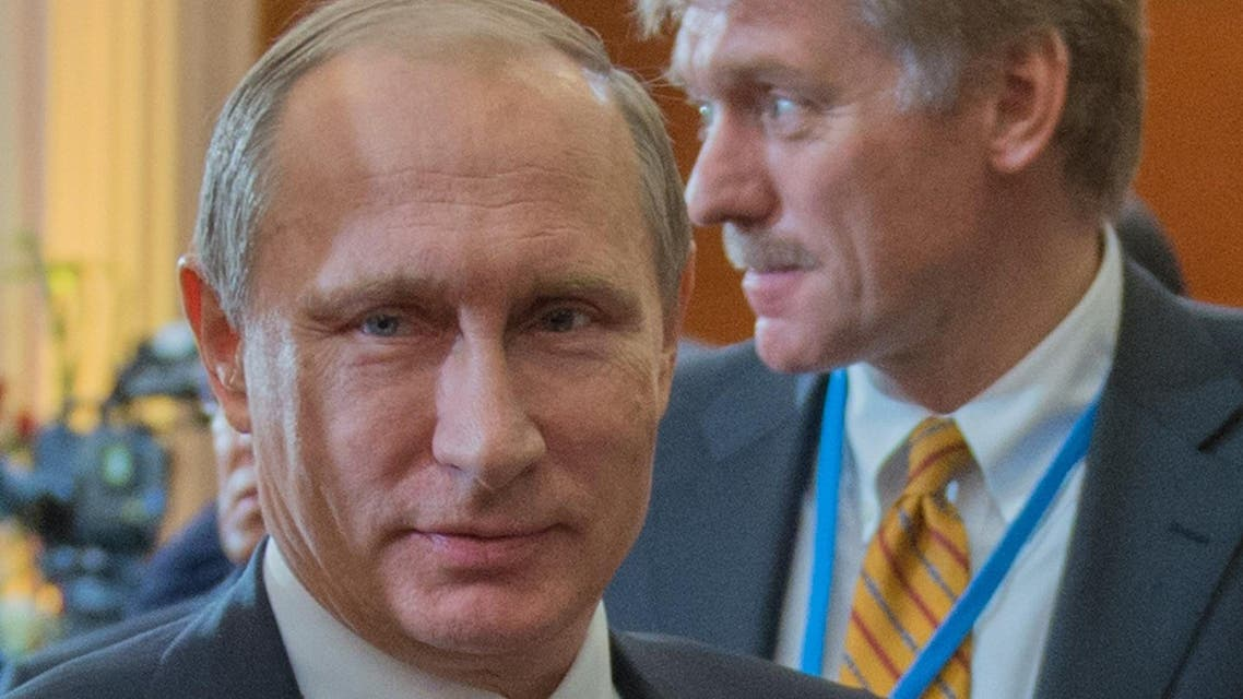 Russian President Vladimir Putin (L) and Kremlin spokesman Dmitry Peskov attend the Commonwealth of Independent States (CIS) leaders summit in Astana on October 16, 2015. (AFP)