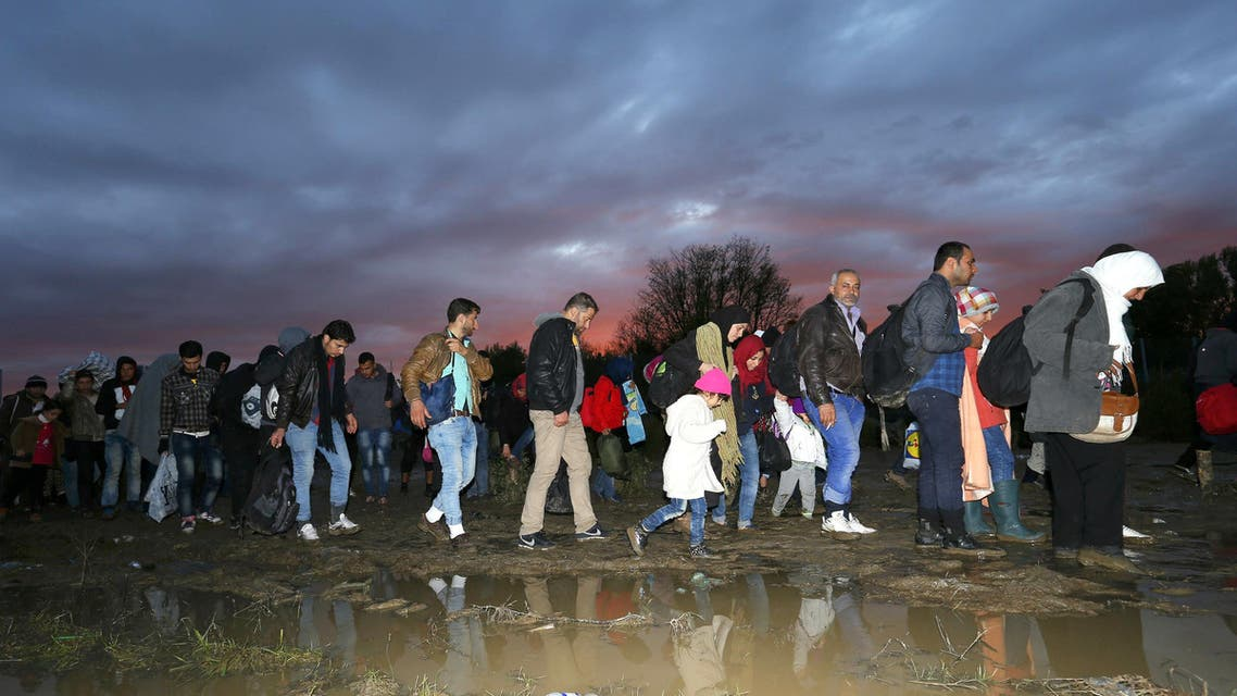 Migrants make their way after crossing the border at Zakany, Hungary October 16, 2015. (Reuters)