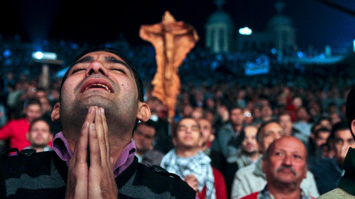 In this Thursday, Dec. 13, 2012 photo, Egyptian Christians gather for a prayer rally ahead of the constitutional referendum at Samaan el-Kharaz church in Cairo, Egypt.
