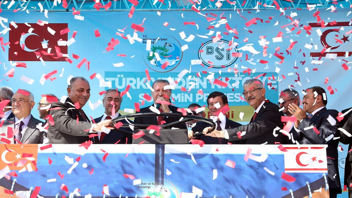 Turkish President Recep Tayyip Erdogan, center left, Turkish Cypriot leader Mustafa Akinci, third left, Turkish Prime Minister Ahmet Davutoglu, fourth right, Turkish Deputy Prime Minister Tugrul Turkes, second left, inaugurate an undersea pipeline to carry fresh water from Turkey to the breakaway Turkish Cypriot north of Cyprus _ a project which Greek Cypriot officials have decried as a Turkish ploy to cement its grip on the island, during a ceremony in Anamur, Turkey, Saturday, Oct. 17, 2015.(AP Photo/Presidential Press Service, Pool)