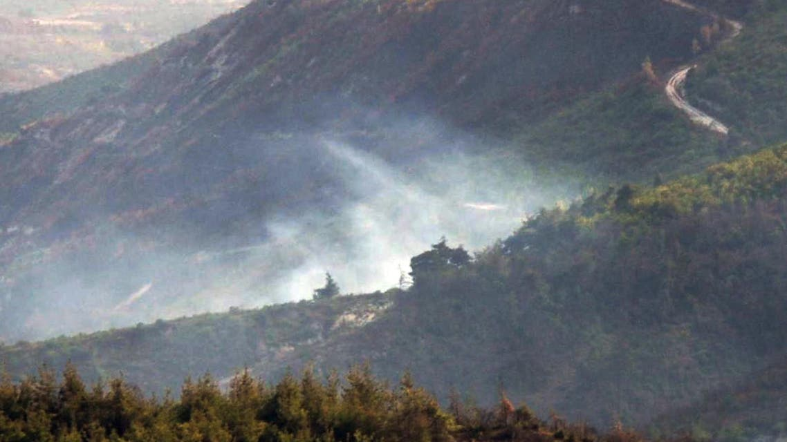 Smoke rises from the Syrian side of the border after a Turkish air force jet downed a Syrian military helicopter at the Turkey-Syria border near Hatay province, Turkey, Monday, Sept. 16, 2013. AP