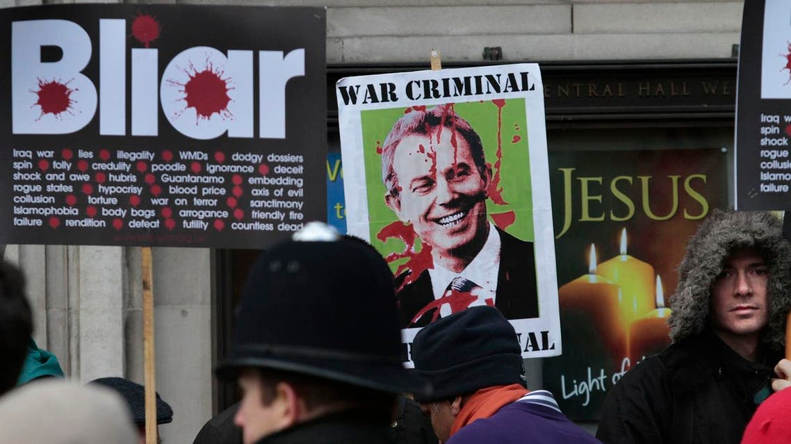 Protesters demonstrate against former British Prime Minister Tony Blair outside the venue where the Iraq inquiry is being held, in central London, Friday, Jan. 21, 2011 AP