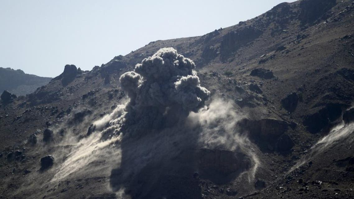 Smoke billows from a military arms depot after it was hit by a Saudi-led air strike on the Nuqom Mountain overlooking Yemen's capital Sanaa