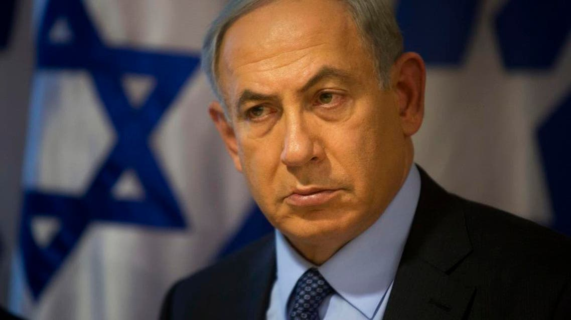 """Israeli Prime Minister Benjamin Netanyahu looks on during a press conference at the Foreign Ministry in Jerusalem, Thursday, Oct. 15, 2015. Netanyahu on Thursday said he would be """"perfectly open"""" to meeting with Palestinian President Mahmoud Abbas in order to end weeks of Israeli-Palestinian unrest. (AP Photo/Sebastian Scheiner)"""