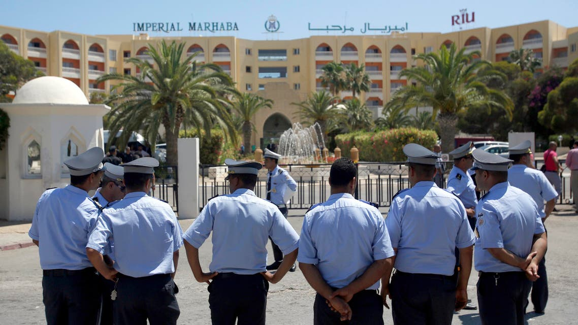 FILE - This Monday, June 29, 2015 file picture shows Tunisian police officers guarding Imperial Marhaba hotel during visit of top security officials of Britain, France, Germany and Belgium in Sousse, Tunisia. Spanish company RIU, which operated the Imperial Marhaba Hotel targeted in a deadly attack on the resort of Sousse in June, said Monday that it is in talks with owners of the 9 properties it currently operates in Tunisia about their future. The head of the Tunisian Hotel Federation, Radhouane Ben Salah, told the Associated Press that RIU's decision was prompted by difficulty in marketing Tunisia as a tourist destination after the attacks, and that the hotels would close by Sept. 30. (AP Photo/Darko Vojinovic, File)