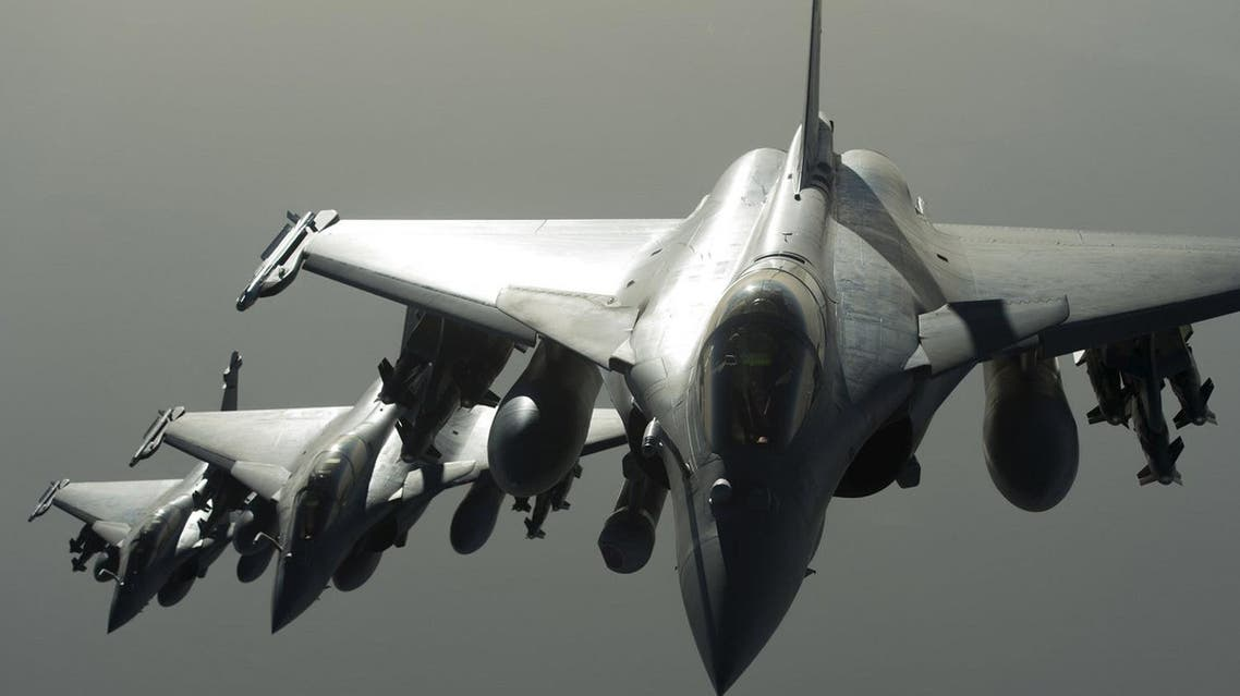 An ECPAD handout photo shows French Army Rafale fighter jets in operation as France launched its first air strikes against Syria. (Reuters)